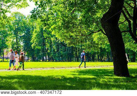 St Petersburg, Russia - June 6, 2019. Summer View Of People Walking In The Mikhailovsky Garden, A La