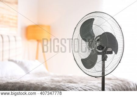 Modern Electric Fan In Bedroom. Space For Text