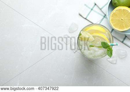 Flat Lay Composition Of Delicious Lemonade With Soda Water And Mint On Light Grey Table, Space For T