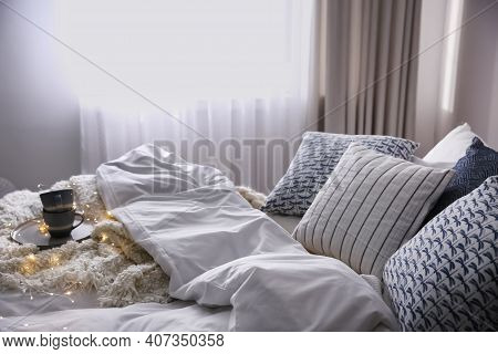 Bed With Warm Blanket And Cushions In Room. Interior Design