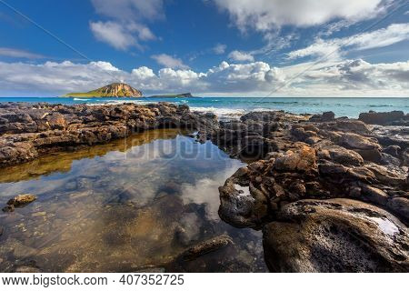 rocks close to Macapuu beach with Manana (also known Rabbit island) and Kaohikaipu islands in background, Oahu, Hawaii