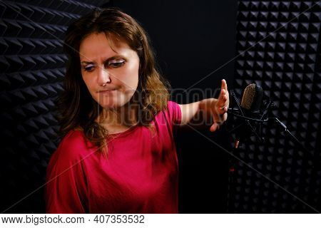 The Young Woman Refuses To Sing And Turns Away From The Microphone. Trouble, Misfortune, Illness Of