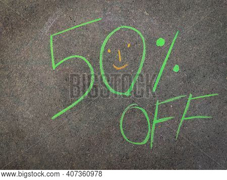 The Inscription Text On The Grey Board, 50% Off. Using Color Chalk Pieces.