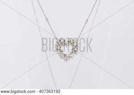Classic Heart Shaped Diamond Pendant Necklace On Transparent Stand. Love Symbol. White Gold With Dia