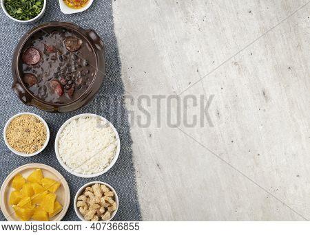 Traditional Brazilian Feijoada With Rice, Kale, Orange, Cracklings, Manioc Flour And Copy Space.