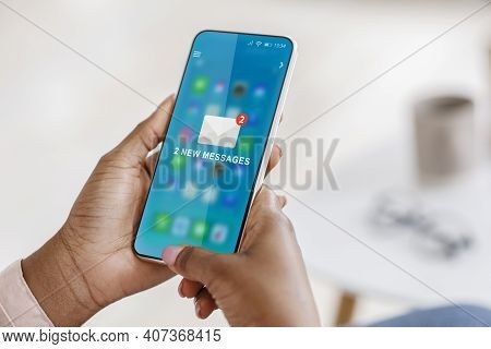 New Messages. Black Woman Using Smartphone With New E-mail Message Notification Sitting In Office. E