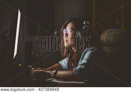 Portrait Of Asian Businesswoman Sitting And Working Hard On The Table With Front Of Computer Desktop