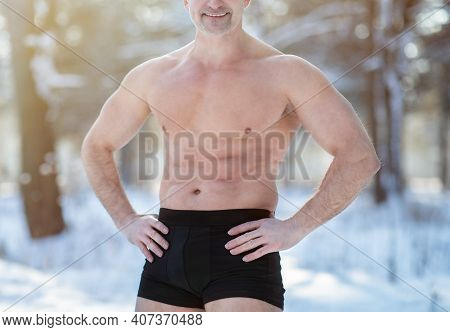 Cold Resistance Training Concept. Unrecognizable Senior Man With Naked Torso Posing In His Underwear