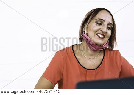 Smiling Woman 40 Years Old Wearing Open Protective Face Mask Using Laptop During The End Of Coronavi