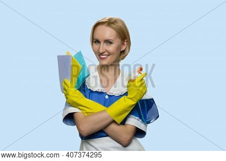 Smiling Housemaid Is Armed With Items For Cleaning. Caucasian Cleaning Lady With Rags Isolated On Bl
