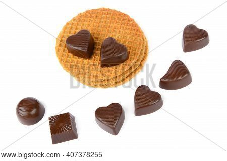 Various Chocolate Pralines And Waffles Isolated On White Background.