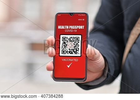 Concept For Corona Virus Vaccine Passport On Mobile Phone Device To Allow Vaccinated People Privileg