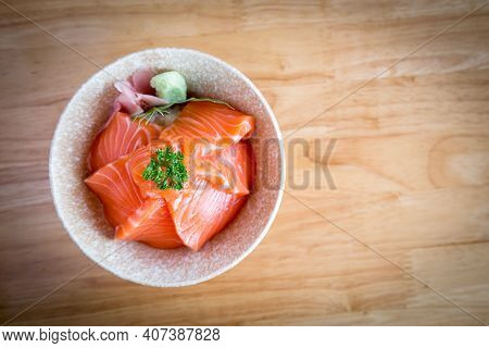 Salmon Don Consisting Of Sliced Salmon On Top Of Japanese Rice Served With Wasabi.