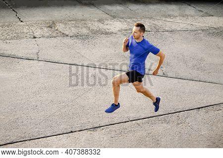 Man Athlete Runner Running On Concrete Road