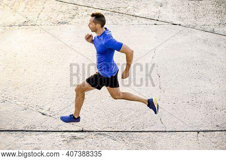 Male Athlete Runner Run On Concrete Road