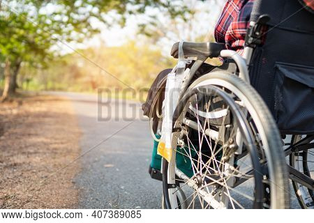 Lady Woman Patient On Wheelchair In Park, Healthy Strong Medical Concept.