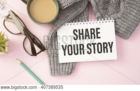 Share Your Story Written On The Paper On A Pink Background