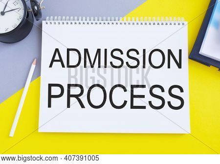 Admission Process Text Written On A Notebook With Pencil, Yellow And Gray Background