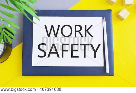 Work Safety Message Text Written On White Paper Above Notebook.conceptual Photo Policies And Procedu