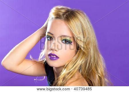 Blond children fashiondoll girl fashion makeup on purple background