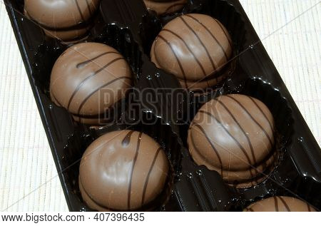 Cool Tender Milk Chocolate Candies With Cream Are Packed In A Plastic Mold.