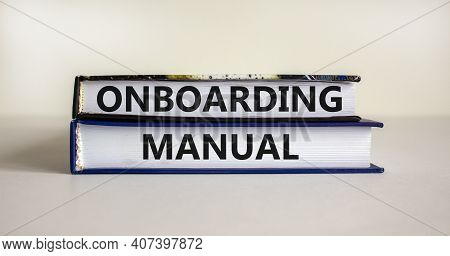 Onboarding Manual Symbol. Books With Words 'onboarding Manual' On Beautiful White Background. Busine