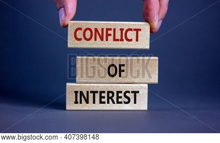 Conflict Of Interest Symbol. Businessman Hand. Wooden Blocks With Words 'conflict Of Interest'. Beau