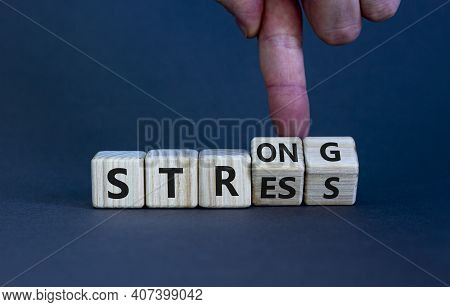 Strong Stress Symbol. Businessman Turns Wooden Cubes With Words 'strong Stress'. Beautiful Grey Back
