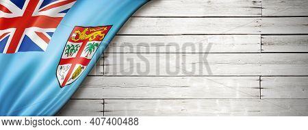 Fiji Flag On Old White Wall. Horizontal Panoramic Banner. 3d Illustration