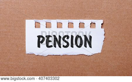 On A Brown Background, White Paper With The Inscription Pension