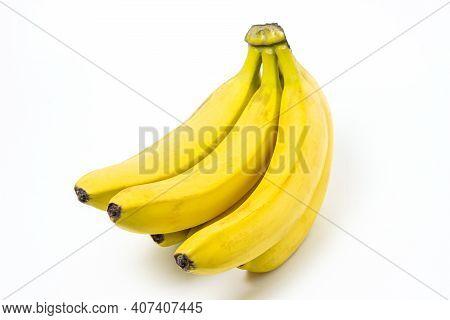 Bananas On A White Background. Fresh Yellow Bananas. Banana Bunch Isolated. Exotic Fruit