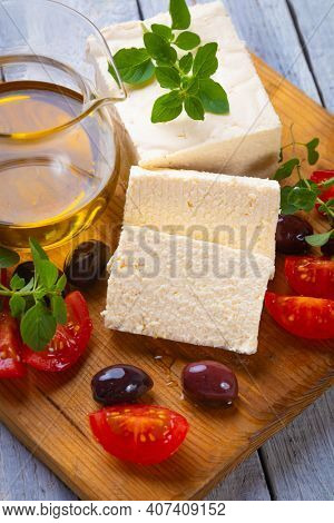 Greek feta cheese slices with kalamata olives and herbs
