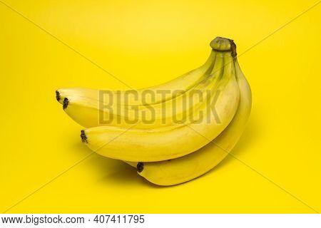 Bananas On A Yellow Background. Fresh Yellow Bananas. Banana Bunch. Exotic Fruit