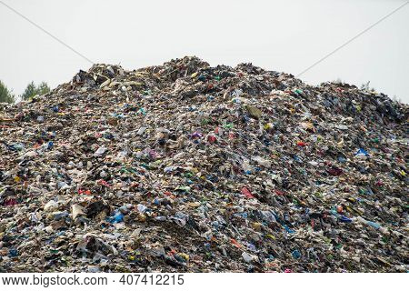 Huge Landfill Of Big City. Large Pile Of Different Garbage. Environmental Pollution. Waste Sorting.
