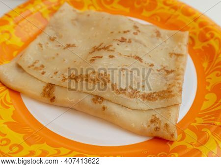 Pancake With Filling On A Patterned Plate. Pancake Week Food Concept