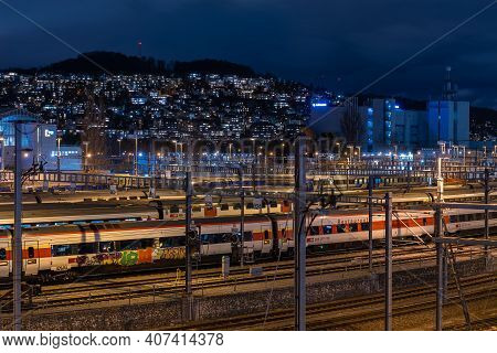 Zurich, Switzerland - February 5, 2021: Zurich Main Railway Station At Night. Serving Up To 2,915 Tr