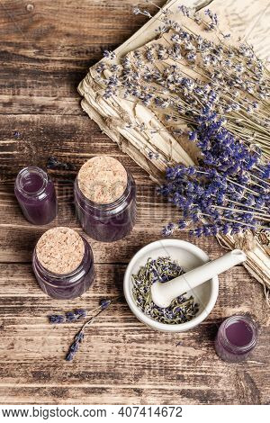 Dried Lavender Flowers In A In A Mortar And Pestle With Bottle Of Essential Lavender Oil Or Infused