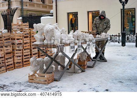 Kazan, Russia - January 08 2021: Street Vendor Of Sculptures On A Pedestrian Street. Bauman Street I