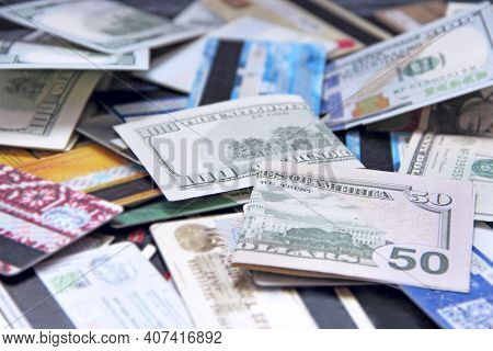 Banknotes With Credit Cards. Cash And Non-cash Money. U.s. Dollars. Fifty Dollars And Pile Of Credit