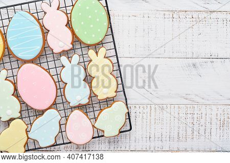 Easter Greeting Card With Colorful Rabbits, Eggs, Chickens And Carrots Gingerbread Cookies On White