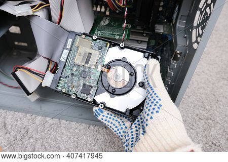 Moscow, Russia - September 10, 2020: Engineer Changing The Hard Drive Of An Office Computer, Repairi