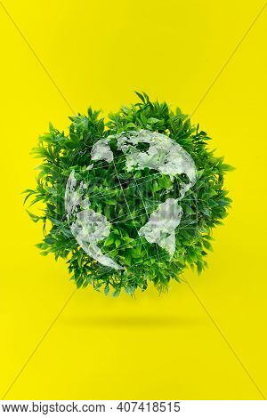 World Environment Day. Ecological Concept-a Globe Of Grass On A Yellow Background. Environmentally F