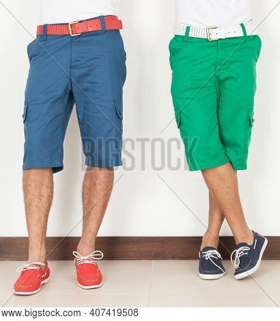 Two Men In Shorts Green And Blue Colors On White Background.