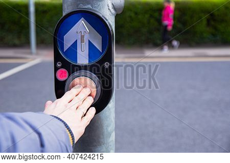 Male Hand Pushing Button For Traffic Light. Use Traffic Lights At The Crossroads. Button Of The Mech