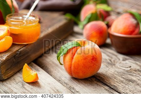 Whole Peach Fruit And Wedges For Making Jam. Peach Fruit With Leaf. Ripe Juicy Orange Peach Fruit On