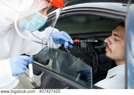 Drive-thru Coronavirus Covid-19 Test,paramedic In Personal Protective Equipment & Face Shield Perfor