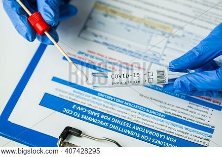 Medical Worker Holding Swab Sample Collection Kit,test Tube For Performing Patient Nasal Swabbing,ha