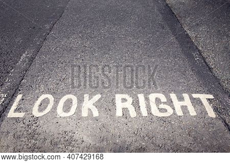 Look Right Warning Painted On The Tarmac In London, England, Uk, Ireland