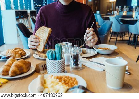 Man Eating Vegetarian English Breakfast Meal In The Hotel Restaurant. Continental Breakfast Concept.