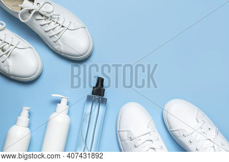 White Leather Sneakers, Plastic Bottles Of Cleaning Products For Shoes On Blue Background Flat Lay T